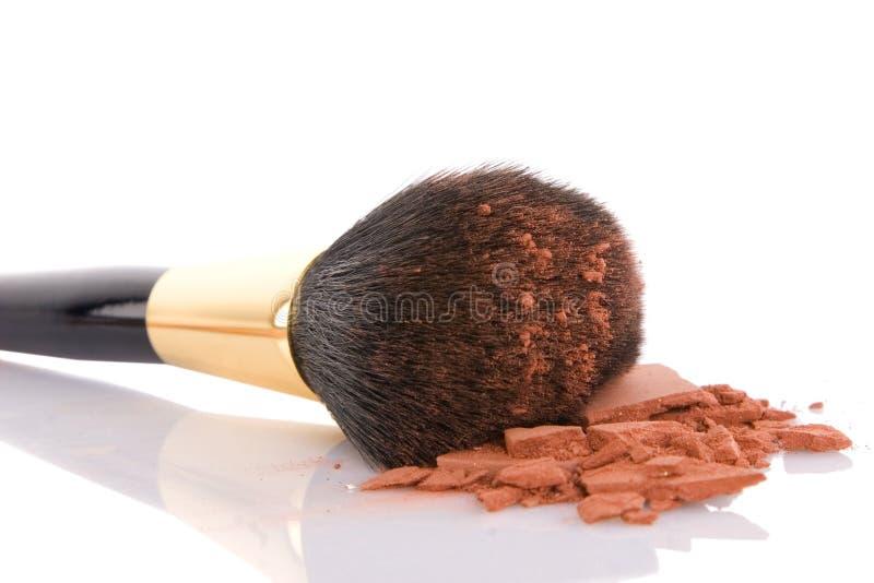 Make-up brush and brown powder royalty free stock photography