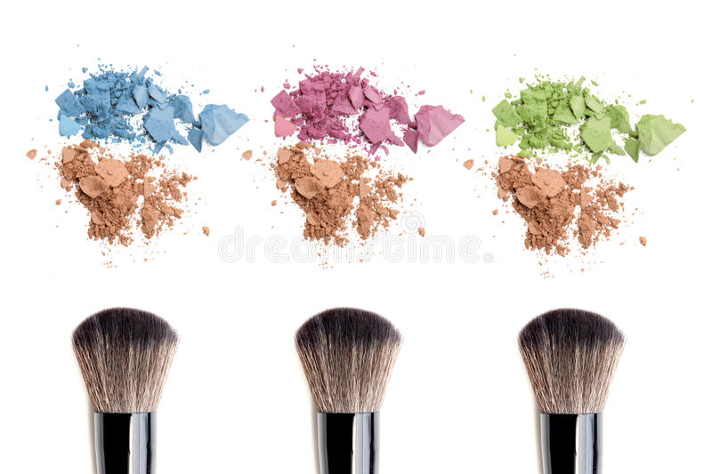 Make-up brush and color powder isolated on white background. stock images