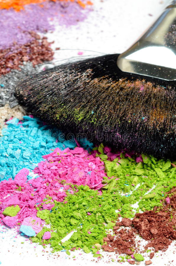 Make-up brush on colorful crushed eye stock photos