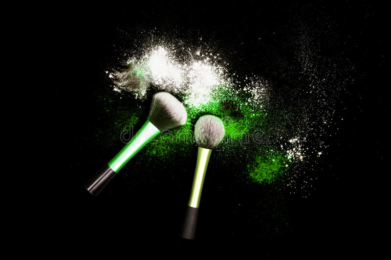 Download Make-up Brush With Colorful Powder On Black Background. Explosion Stars Dust With Bright Colors. White And Green Powder. Stock Photo - Image: 83716791
