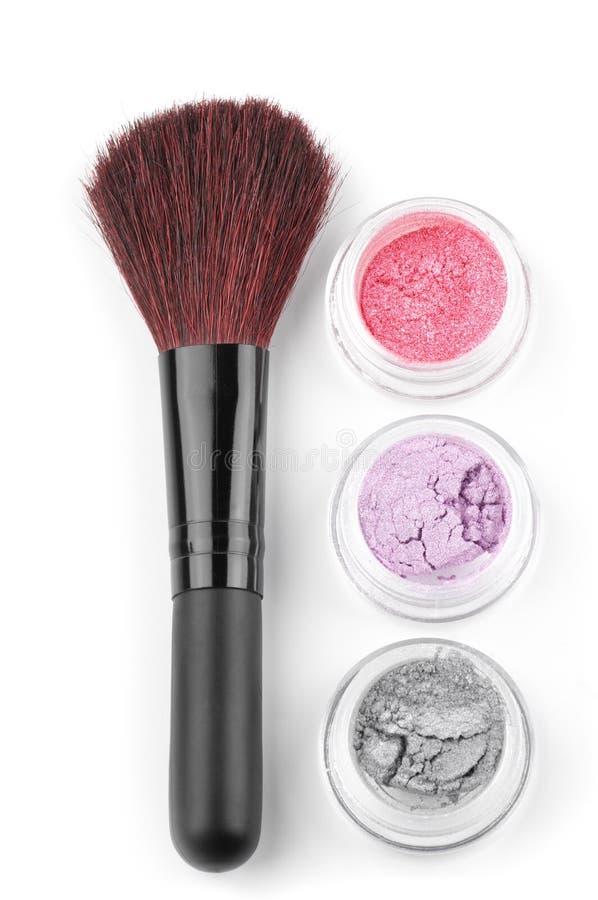 Make-up brush and eye shadows royalty free stock image