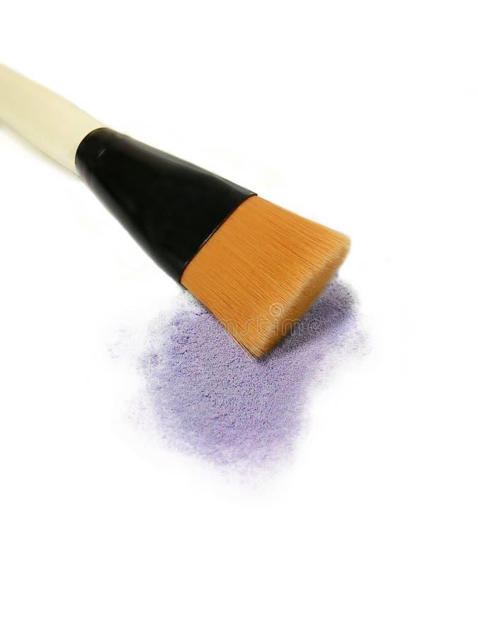 Make-up brush and eyeshadows stock photo