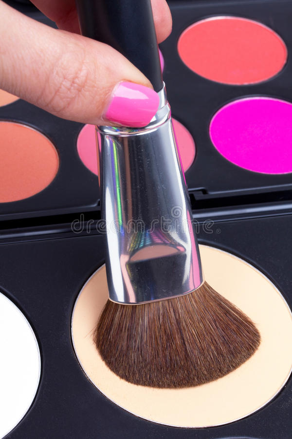 Make-up brush in hand royalty free stock image