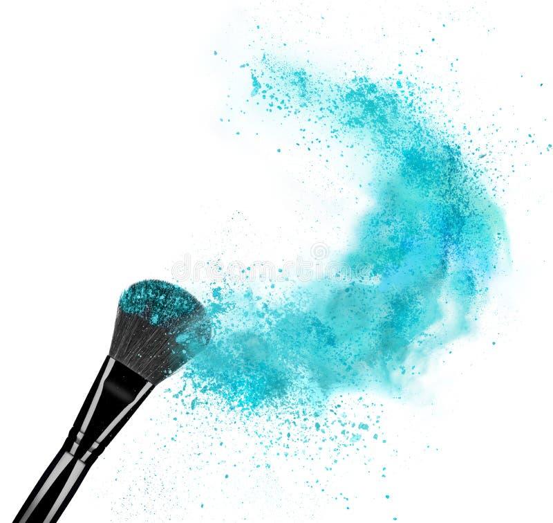 Make up brush with powder splash isolated on white background royalty free stock images