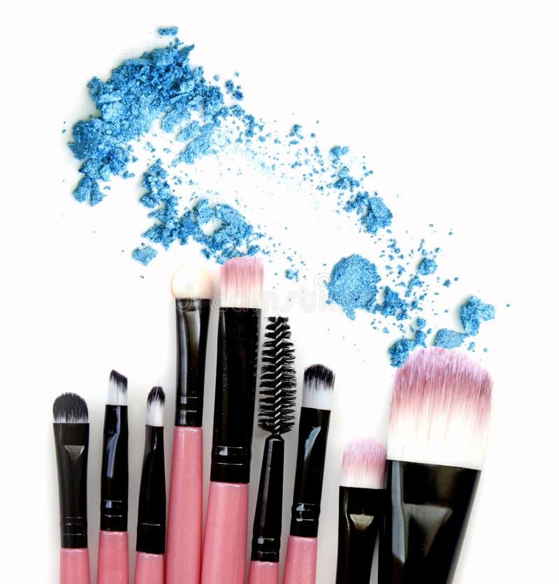 Make up brush set with eye shadow powder. Isolate royalty free stock images