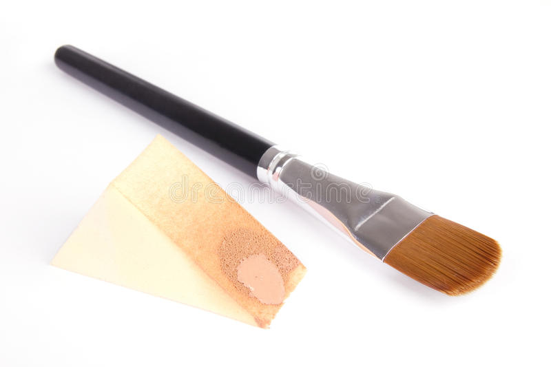 Make-up brush and sponge with foundation royalty free stock photography