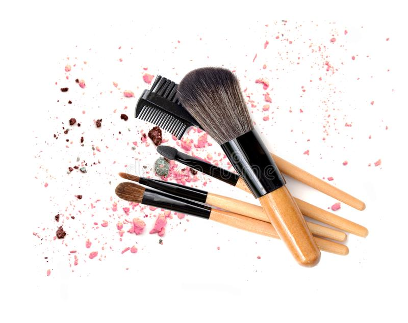 Make up brush wooden on colored dust on white background. royalty free stock image