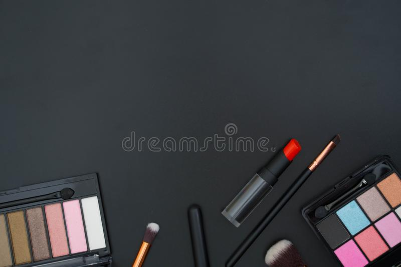 make up and brushes on black stock photos