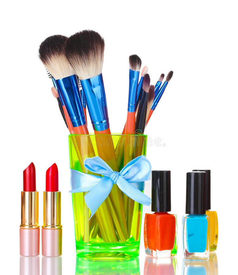 Make-up brushes in cup and cosmetics royalty free stock photography