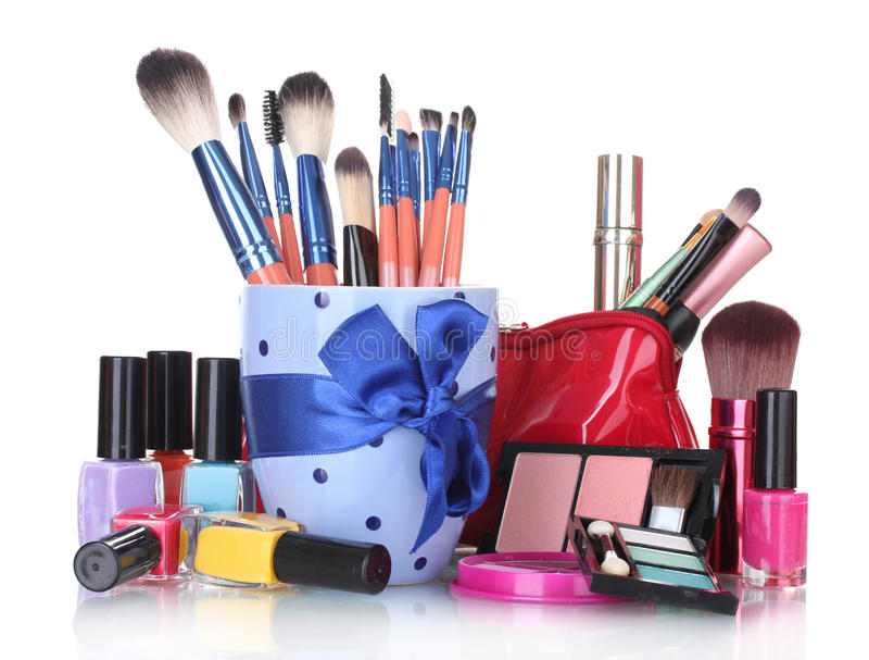 Make-up brushes in cup and cosmetics stock photography