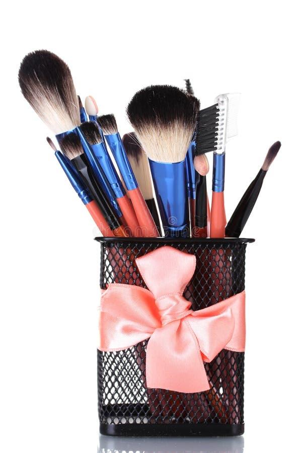 Make-up brushes in holder royalty free stock image