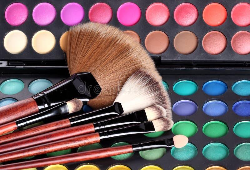 Make-up brushes and makeup shadows royalty free stock photo