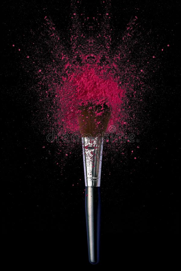 Make up brushes with powder explosion royalty free stock photo