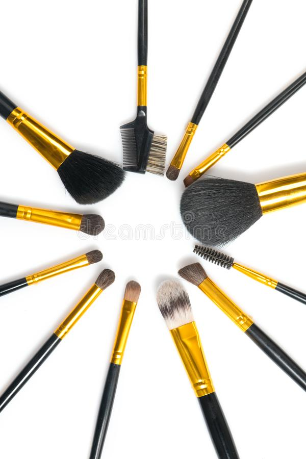 Make-up Brushes set over white background. Various Professional makeup brush on white in studio. Make up artist tools. Flatlay stock photo