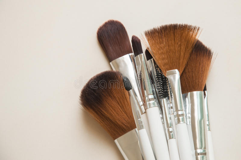 Make-up brushes on white background stock photos