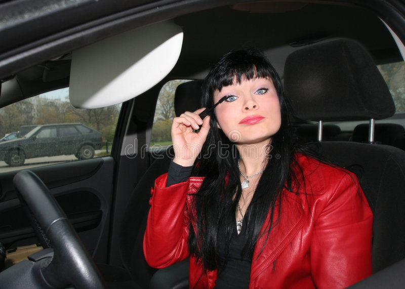 Make-up in the car stock photo