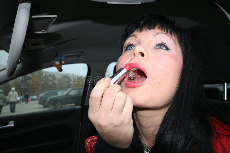 Make-up in the car stock photography