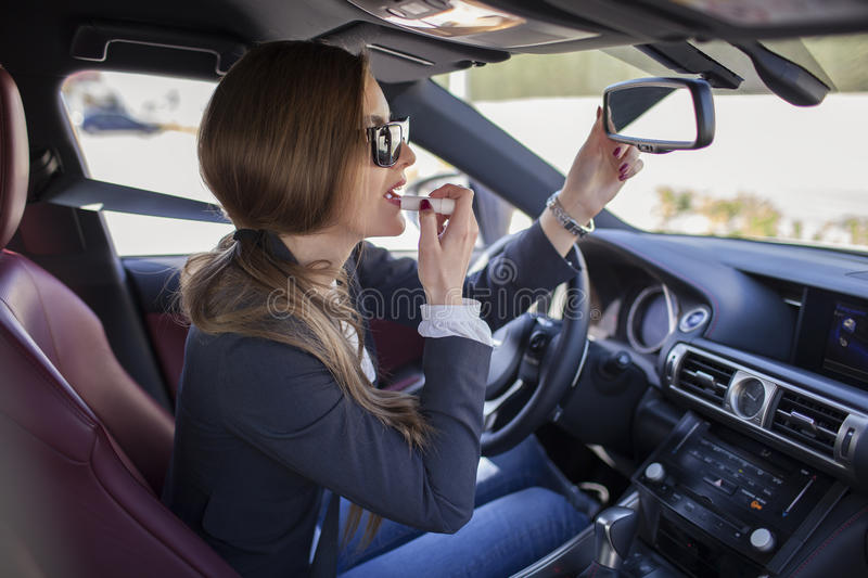 Make-up in the car stock photos
