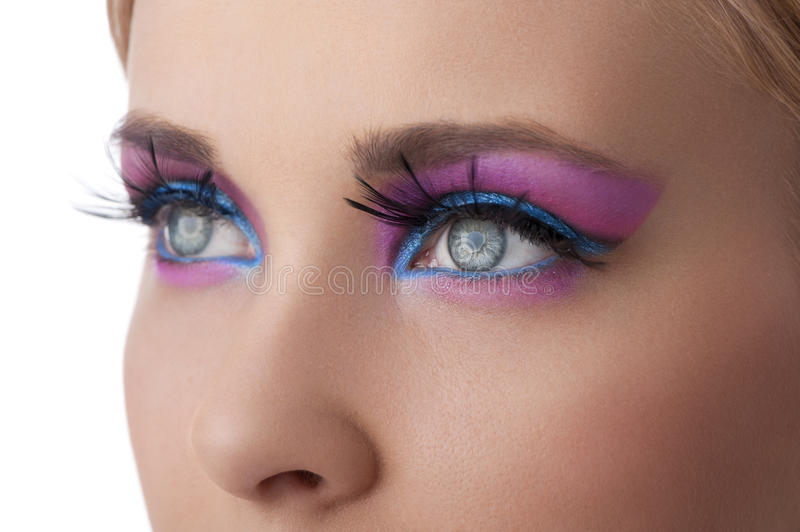 Make up in color eyes closeup stock photography