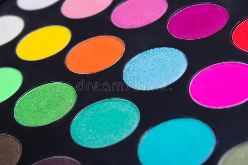 Make-up colorful eyeshadow palette closeup. Make-up colorful eyeshadow palette over black closeup stock photo