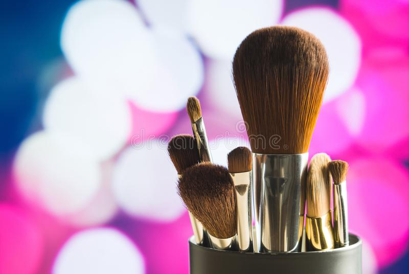 Make up concept on pink and purple background. stock images