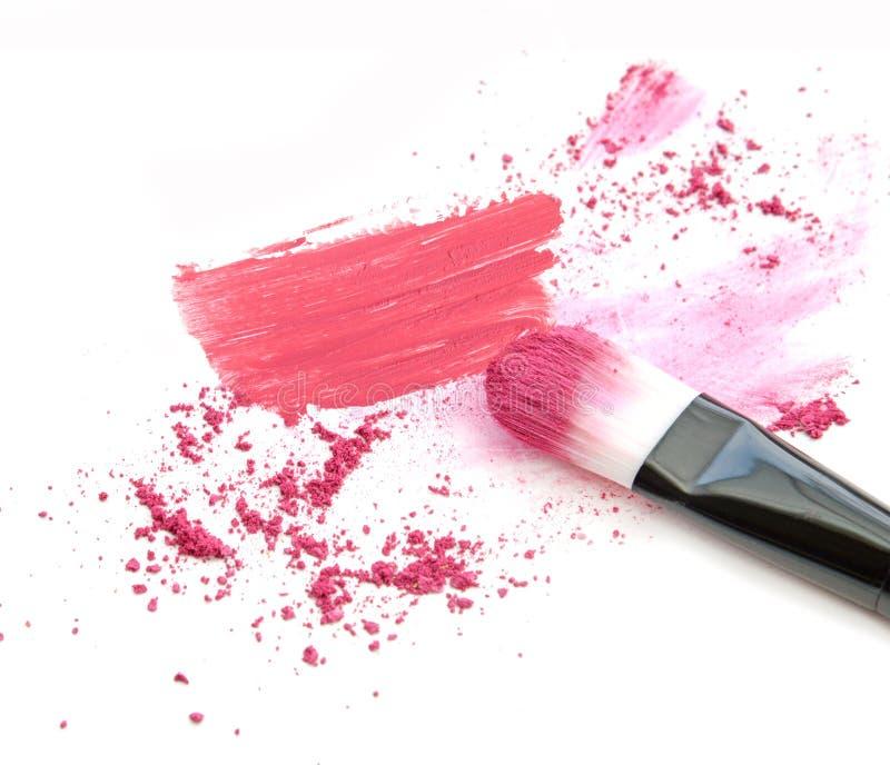 Make up cora pó esmagado e batom manchados imagem de stock royalty free