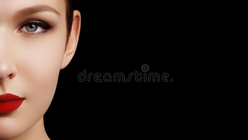Make-up and cosmetics. Beauty woman face isolated on black backg stock images