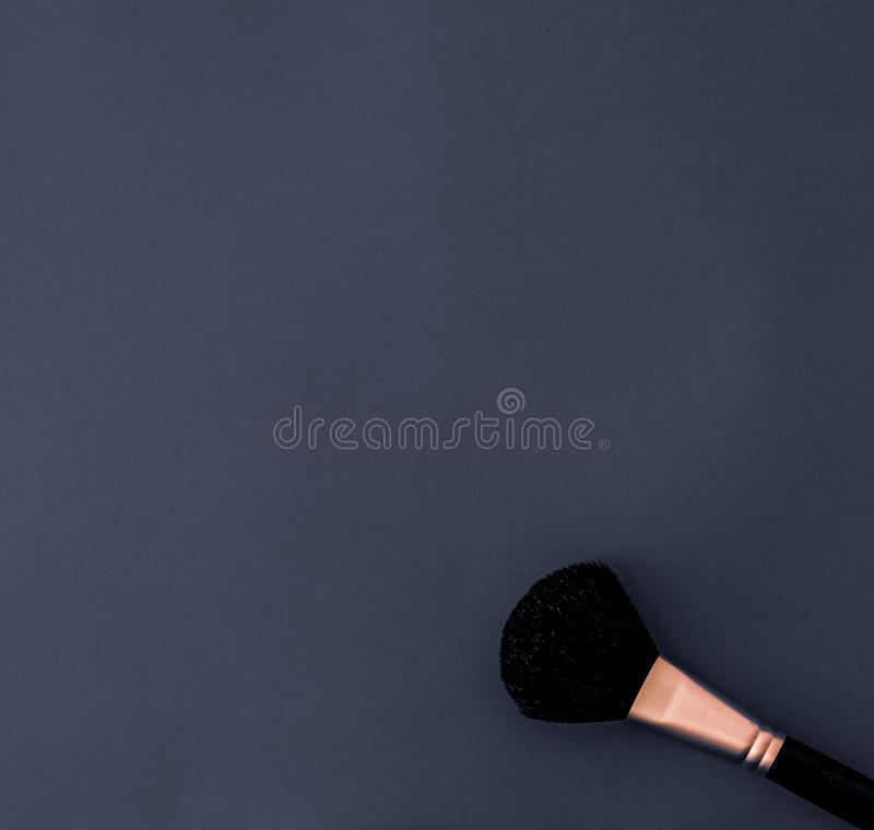 Make-up and cosmetics product set for beauty brand Christmas sale promotion, luxury black flatlay background as holiday design. Cosmetic branding, fashion blog stock photo