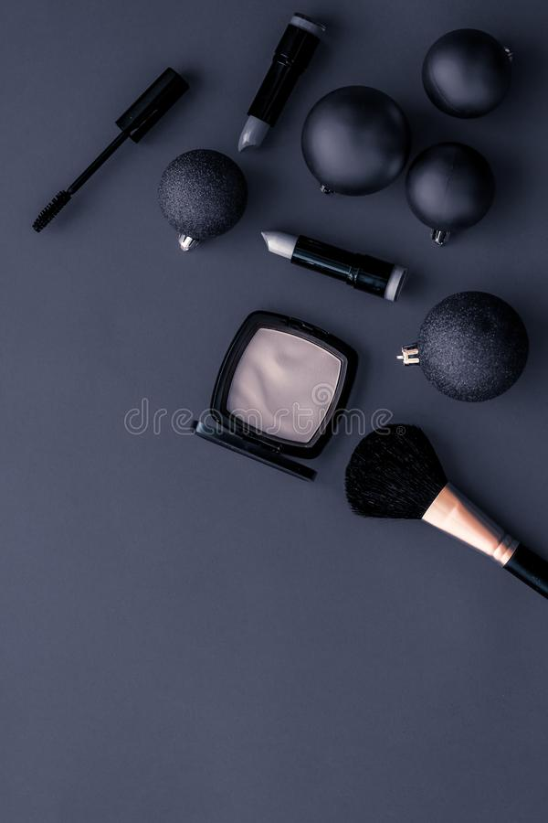 Make-up and cosmetics product set for beauty brand Christmas sale promotion, luxury black flatlay background as holiday design. Cosmetic branding, fashion blog stock photography