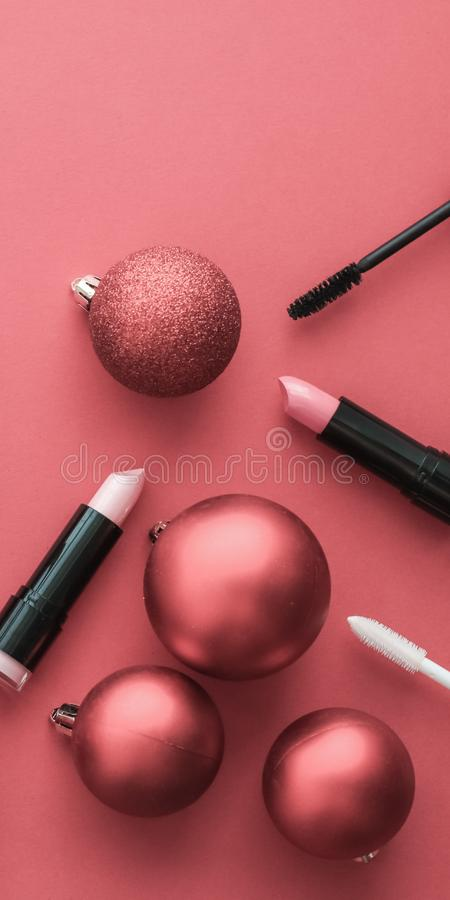 Make-up and cosmetics product set for beauty brand Christmas sale promotion, luxury coral flatlay background as holiday design. Cosmetic branding, fashion blog royalty free stock photography