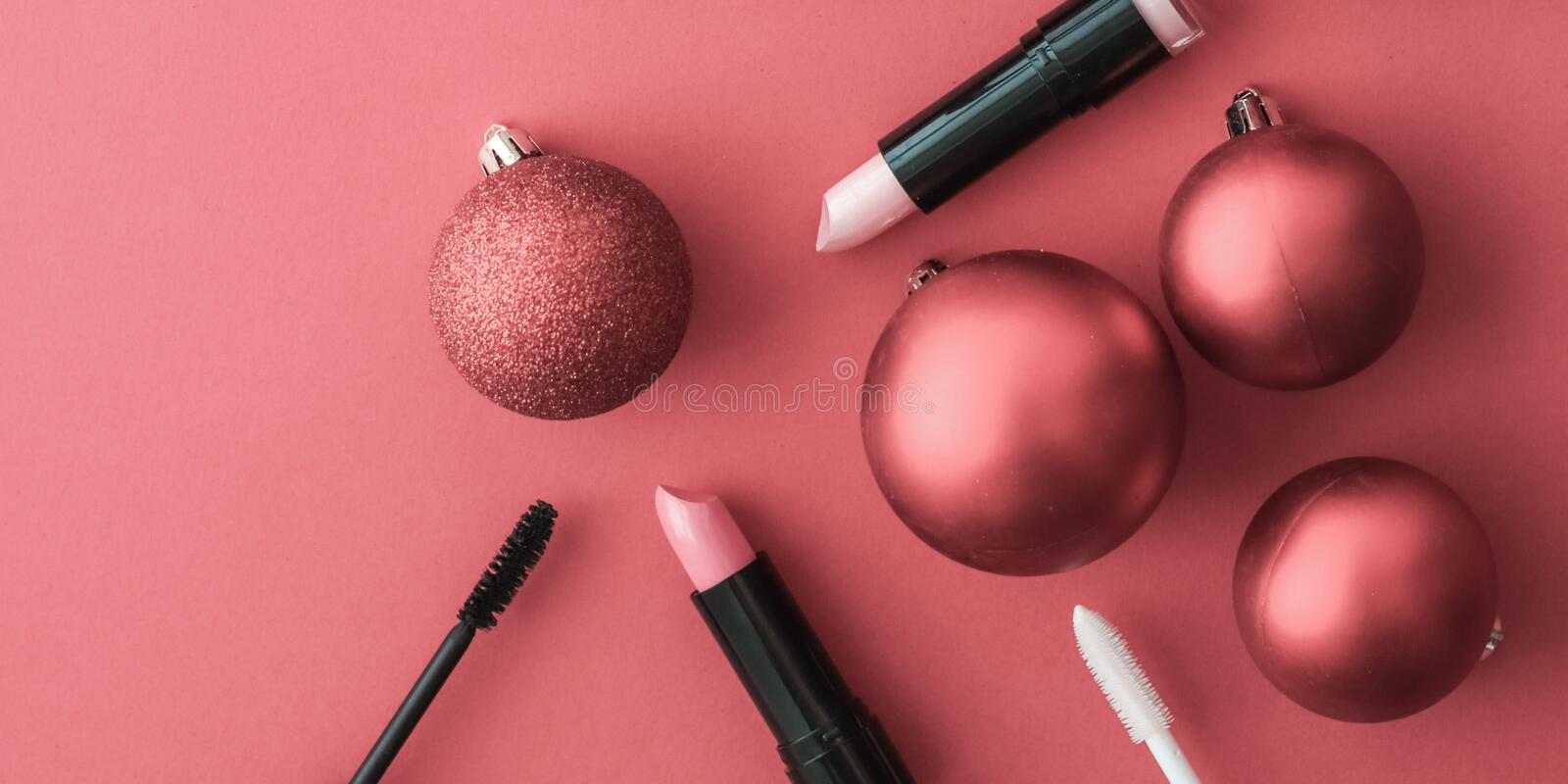 Make-up and cosmetics product set for beauty brand Christmas sale promotion, luxury coral flatlay background as holiday design. Cosmetic branding, fashion blog stock photo