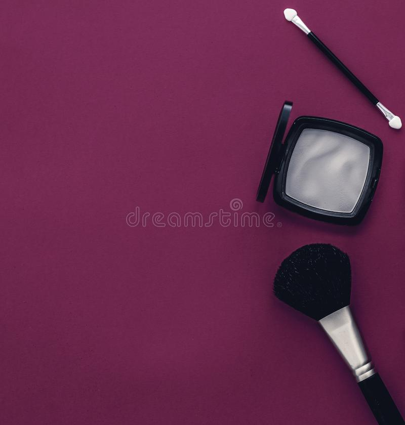 Make-up and cosmetics product set for beauty brand Christmas sale promotion, luxury magenta flatlay background as holiday design. Cosmetic branding, fashion blog stock photo