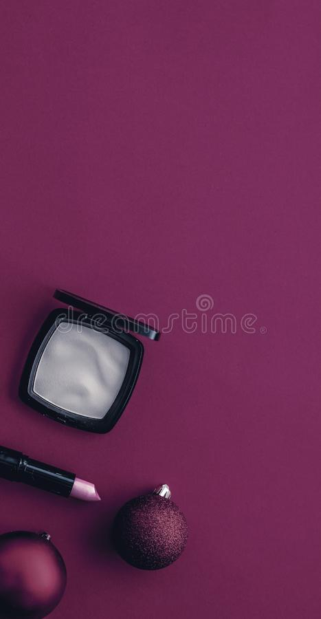 Make-up and cosmetics product set for beauty brand Christmas sale promotion, luxury magenta flatlay background as holiday design. Cosmetic branding, fashion blog stock image