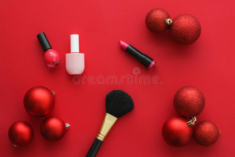 Make-up and cosmetics product set for beauty brand Christmas sale promotion, luxury red flatlay background as holiday design. Cosmetic branding, fashion blog royalty free stock photo