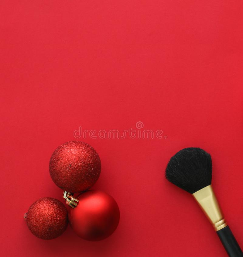 Make-up and cosmetics product set for beauty brand Christmas sale promotion, luxury red flatlay background as holiday design. Cosmetic branding, fashion blog stock photography