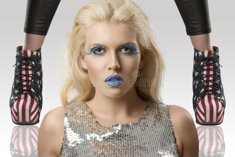 Make-up girl in front of the camera and shoes with stock photography