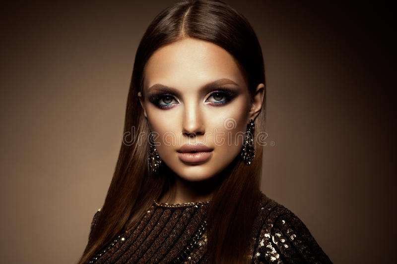Make up. Glamour portrait of beautiful woman model with fresh makeup and romantic hairstyle. royalty free stock photo