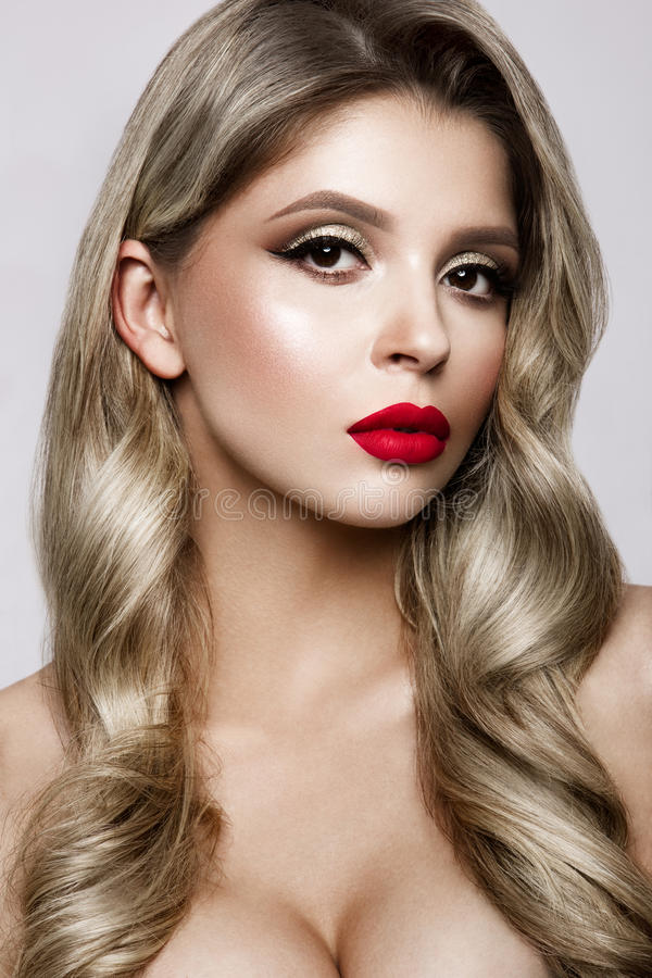 Make up. Glamour portrait of beautiful woman model with fresh makeup and romantic hairstyle. royalty free stock images