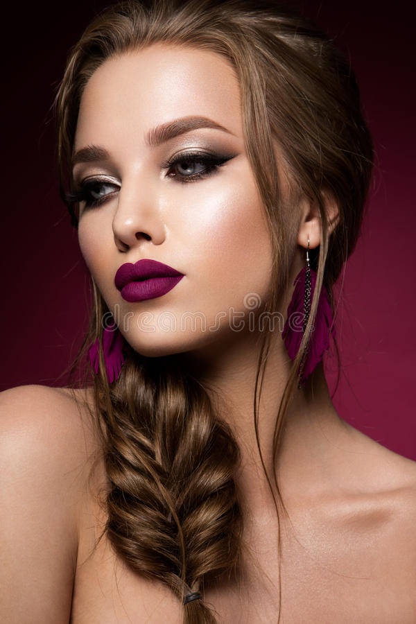 Make up. Glamour portrait of beautiful woman model with fresh makeup and romantic hairstyle. stock photo