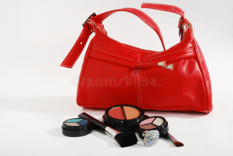 Make-up & handbag. Make-up kits brushies, silver ring and handbag stock photo