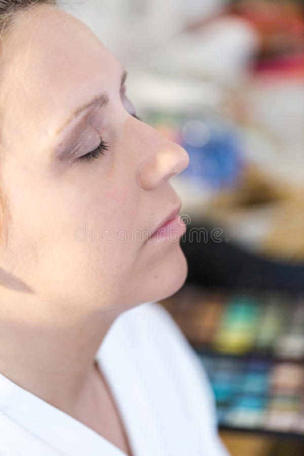 Make up. Makeup artist applying make up to the brides face stock images