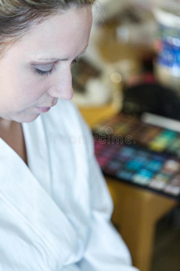 Make up. Makeup artist applying make up to the brides face royalty free stock image