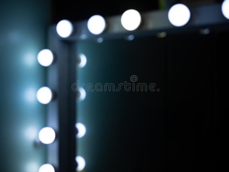 Make-up Mirror. Blurred of The Corner of Make-up Mirror with Light Bulbs with Space royalty free stock photos