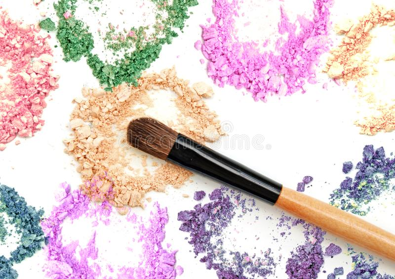 Make up powder color and brush on white background. royalty free stock image