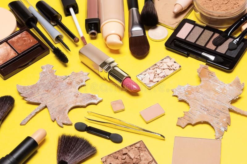Make up products brown and golden colours for autumn makeup royalty free stock image