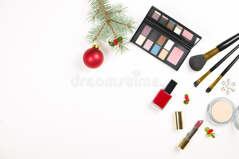 Make up cosmetic with Christmas decoration on white background flat lay royalty free stock photos