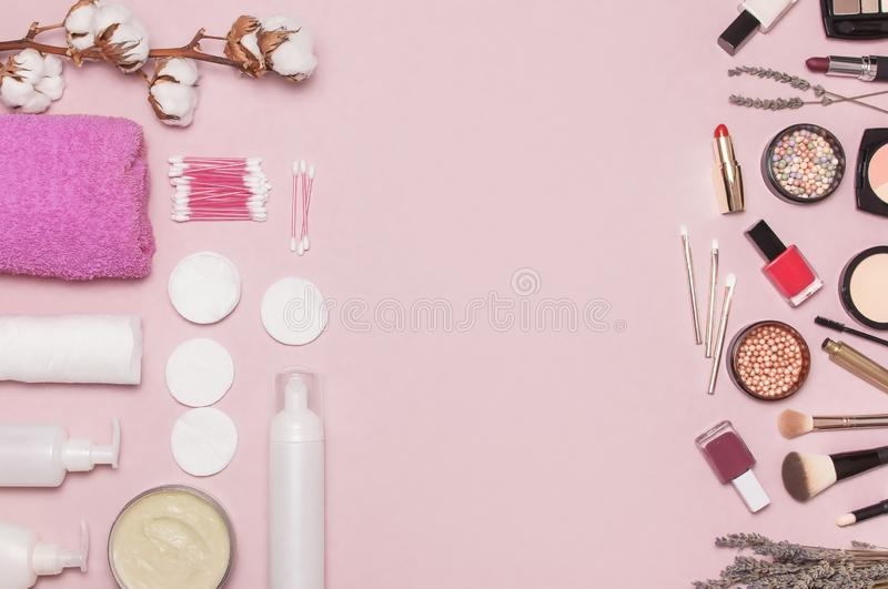 Make-up Remover Accessories. Flat lay background with cotton branch, cotton pads, ear sticks, cosmetic bottle containers, pink tow stock photography