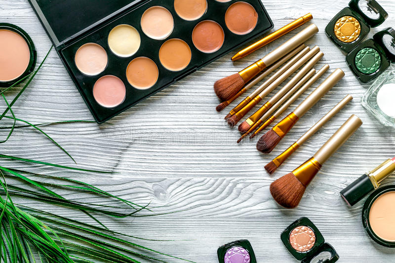Make up set with decorative cosmetics on woman table background top view. Make up set with decorative cosmetics in beauty concept on gray wooden woman table stock photography