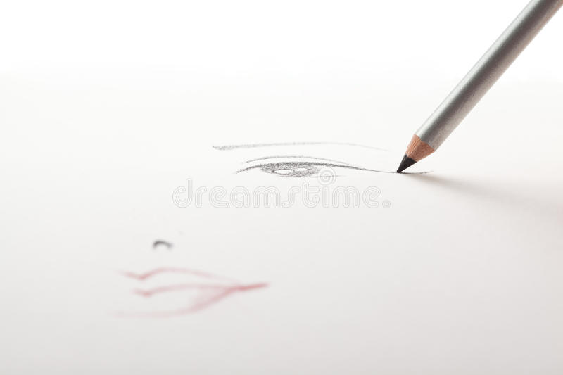 A make-up sketch, black eye liner pencil drawing. A make-up sketch, drawn on white paper, with a black eye liner pencil drawing the eye and the mouth in a blur stock photography
