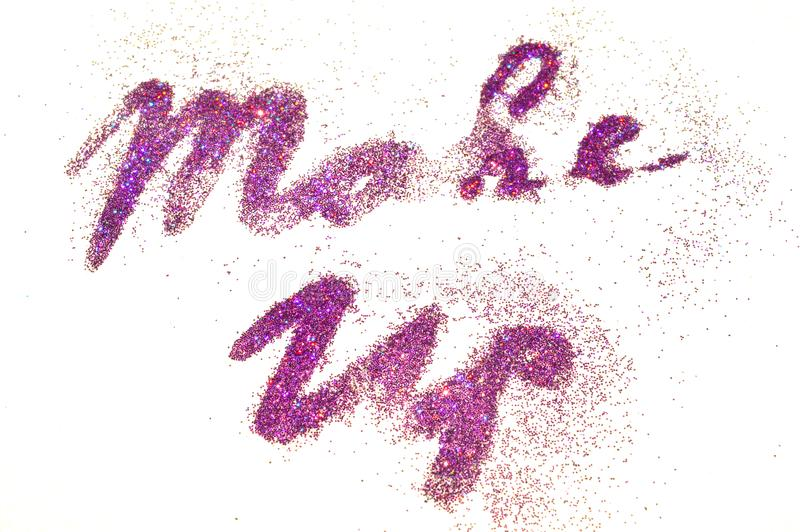 Make Up, words of purple glitter sparkle on white background with bokeh lights stock photography